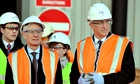 Sir David Higgins (right) views the site for a new HS2 station at Old Common Oak in northwest London
