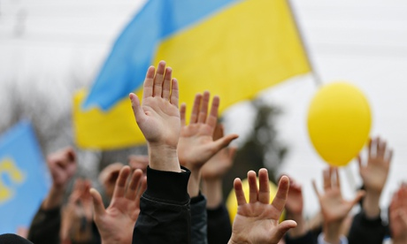 Ukraine supporters raise their hands