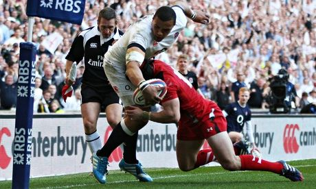 Leigh Halfpenny tackles Luther Burrell