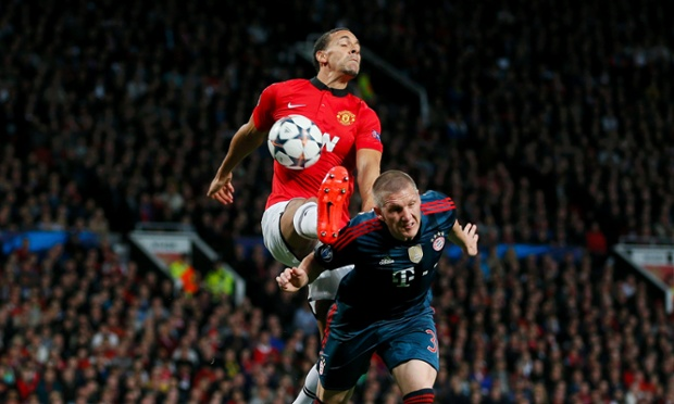 Rio Ferdinand, left, gets up close and personal with Bayern Munich's Bastian Schweinsteiger.
