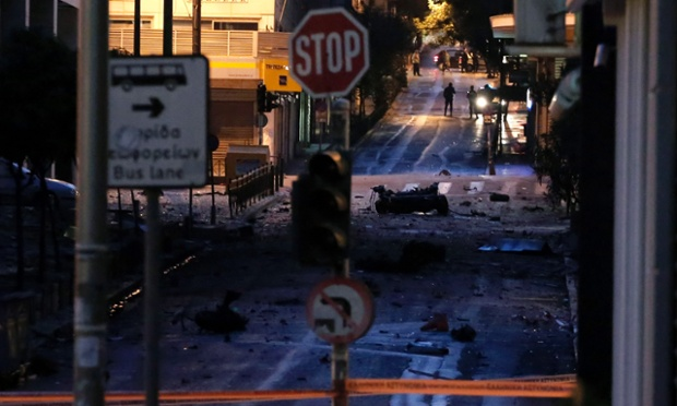 The remains of a car sit on a street after a car bomb explosion in central Athens, on Thursday, April 10, 2014.
