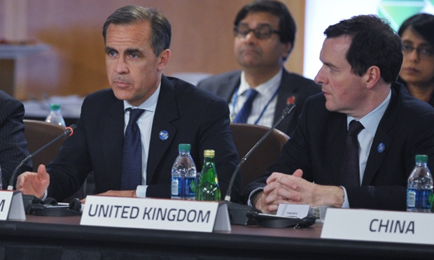 Bank of England Governor Mark Carney (left) speaks while watched by Britain's Chancellor of the Exchequer George Osborne (right) at a G20 ministerial meeting at the International Monetary Fund Headquartersin Washington, DC.