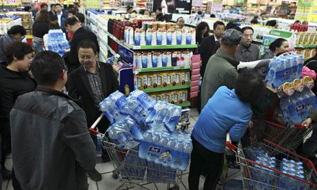 Residents buy bottled water after authorities said Lanzhou's drinking water contained benzene