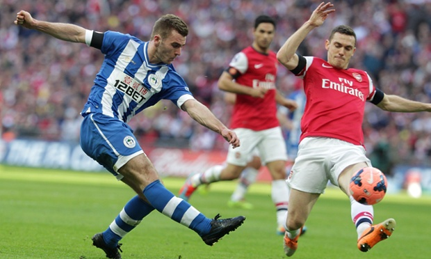 Wigan Athletic's Callum McManaman shoots under pressure from Arsenal's Thomas Vermaelen during the FA Cup semi-final at Wembley.