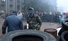 Pro-Russian activists make barricades at government offices in Makeyevka, near Donetsk, Ukraine