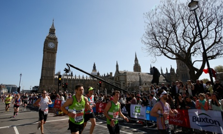 LONDON, ENGLAND - APRIL 13:  Runners pass the Houses of Parliament during the London Marathon on April 13, 2014 in London, England.