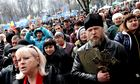 Pro-Russian activists rally in front of seized security service building in Luhansk, Ukraine