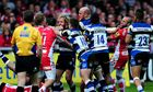 Gloucester and Bath players clash after referee Tim Wigglesworth awards a penalty try to Bath