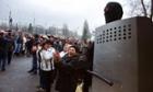 Pro-Russia supporters applaud by a militiaman in Gorlovka, Ukraine.