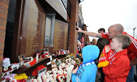 Liverpool fans pause to remember the 96 who died in the Hillsborough disaster 25 years ago