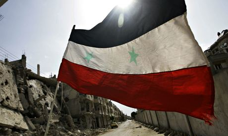 A Syrian flag in Homs