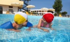 Children playing in a hotel pool
