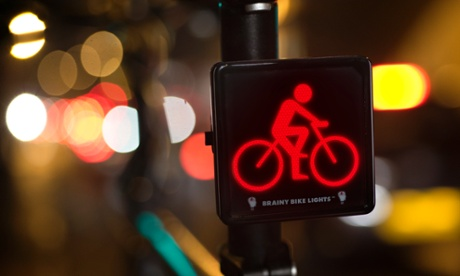 Photo: The illuminated symbol of a bike and rider makes it easier for drivers to pick cyclists out of the urban light clutter, says Brainy Bike Lights inventor Crawford Hollingworth.