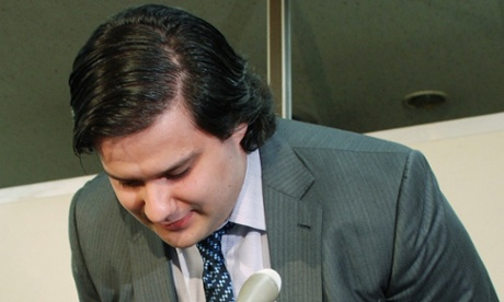Mark Karpeles, president of MtGox bitcoin exchange bows his head during a press conference in Tokyo on February 28, 2014.