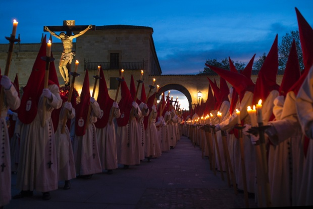 Penitents take part in the Procesion del Silencio by the Cristo de las Injurias brotherhood