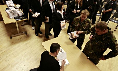 'It doesn't matter what they read' … Male and female soldiers queue to have books signed by author Andy McNab at Tidworth Army Camp, Wiltshire. Photograph: Martin Argles for the Guardian