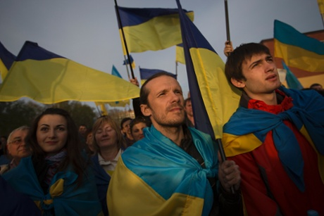 Ukrainians with their national flags gather in support of a united Ukraine in Donetsk, Ukraine, Thursday April 17, 2014.