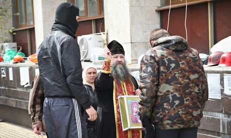 Donetsk priest blesses occupiers