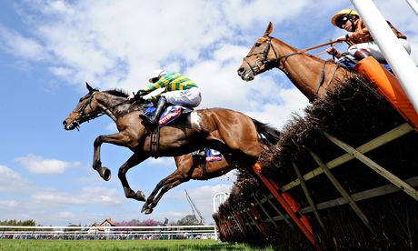 Carlton Jack (centre), ridden by Maurice Linehan, on his way to winning at Haydock