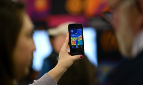 An Apple iPhone being used at the Macworld/iWorld 2014 iFan event at the Moscone Center in San Francisco, California,