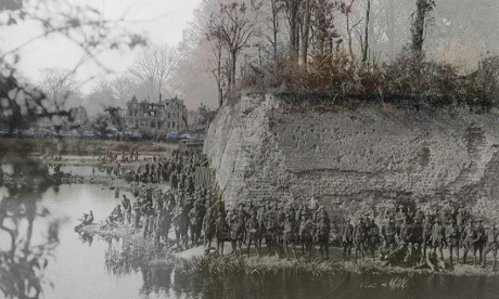 Soldiers stand at the ramparts in Ypres, Belgium, 1917 and the same location in 2013