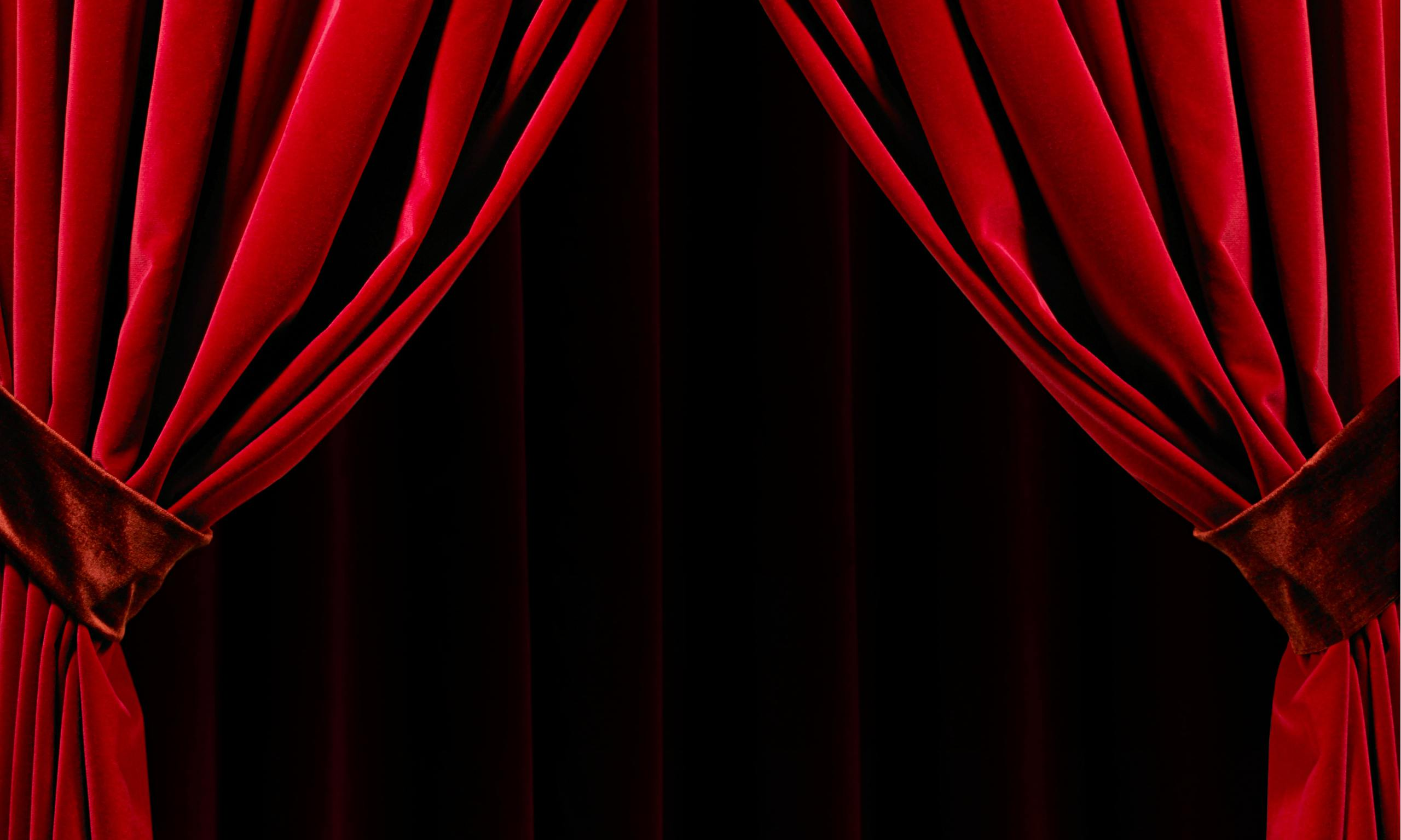 Red stage curtains open -