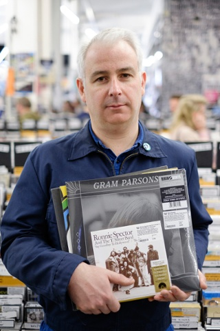 Richard Gibson, 41, from west London poses with some choice cuts; Say Goodbye to Hollywood by Ronnie Spector and the 'E' Street Band and a double album of Gram Parsons alternate takes from GP and Grievous Angel
