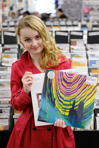Emma Jones, 16, from south London poses with her Tame Impala live album and Pins, Shoot You on heart-shaped vinyl.
