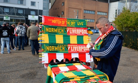 A vendor sells scarves ahead of the Premier League match between Norwich City and Liverpool at Carrow Road.