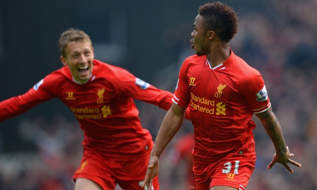 Raheem Sterling celebrates scoring the opening goal for Liverpool, as Lucas Leiva chases gamely.