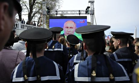 Black Sea fleet sailors watch a televised call-in show with Vladimir Putin in Sevastopol, Crimea
