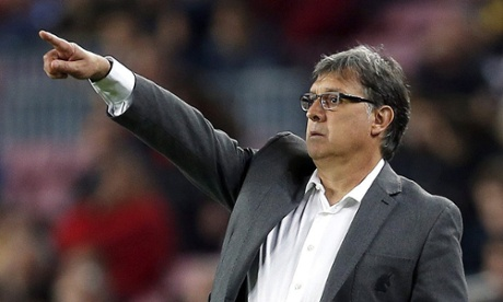 Barcelona coach Geraldo Martino points his players in the direction of the goal.