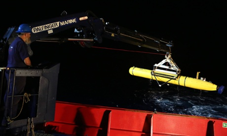 A technician lifts the Bluefin-21 on to the deck of the Ocean Shield after completing a search mission for flight MH370