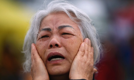 A woman shows her grief at Jindo port where relatives have been waiting while bodies are recovered from the sunken ferry Sewol.
