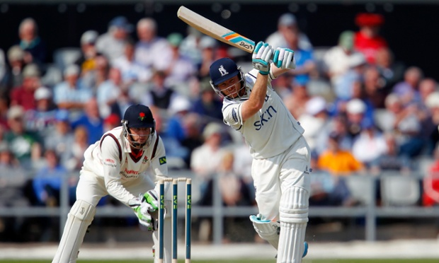 Ian Bell drives through the covers at Old Trafford yesterday.