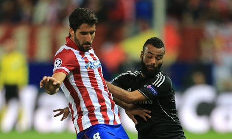 Ashley Cole, sporting said beard and barnet, attempts to get to grips with Raúl García.