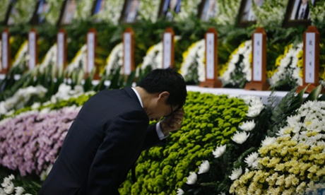 A man bows at a memorial in Ansan, South Korea, for the presumed victims of the Sewol ferry disaster
