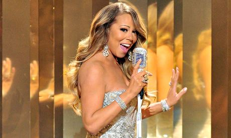 Mariah Carey wiht bare shoulders, smiling,01225 313 009 £170  singing into a microphone
