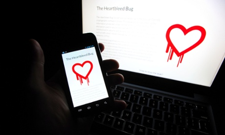 The Heartbleed logo on a phone and laptop.