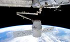 Dragon cargo vessel ggrappled by ISS robotic arm