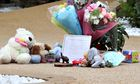 Floral tributes and toys outside Clarence family home