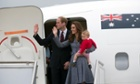 Prince William and Kate wave as they board their plane at Canberra airport on Friday.