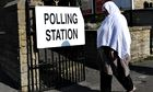 A woman arrives to cast her vote in the Bradford West by-election.