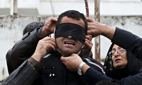 Samereh Alinejad and her husband Abdolghani remove the noose from Balal.