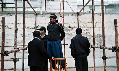 Balal stands in the gallows during his would-be execution ceremony.