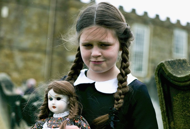 Colette Rimmer, 10, from Wigan poses with a spooky doll. ~ Getty Photograph by Ian Forsyth