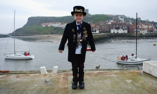 Young steampunk Robin Middlehurst, 8, from Cheshire shivers on the shore ~ Getty Photograph by Ian Forsyth