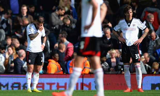Goalscorers Fernando Amorebieta, right, and Ashkan Dejagah of Fulham look dejected at the final whistle against Hull City.