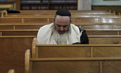 A Jewish man attends the morning prayer at a synagogue in Donetsk, Ukraine. Photograph: Baz Ratner/Reuters