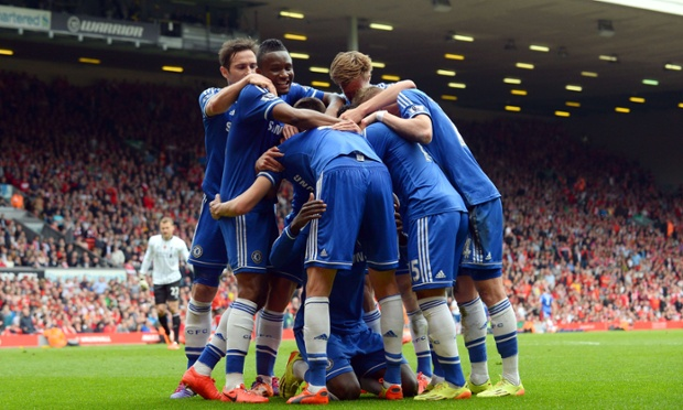 Chelsea's players celebrate with Demba Ba after his opening goal.